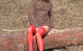 Miss In Red Stockings Piddling Outdoors