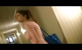 Sexy brunette babe shows peeing desperation in hotel