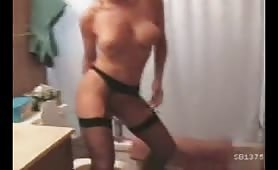 hot blonde with big tits is making yellow streams of urine