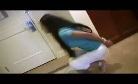 Asian babe pees in her white pants