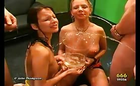Piss sharing with hot babes who use a straw to drink pee together