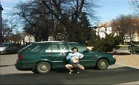 crazy teen pissing wild behind a car