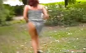 Hot redhead mama and public park pissing action