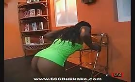 Sexy black girl spits out pee on a glass plate and then licks cum from it