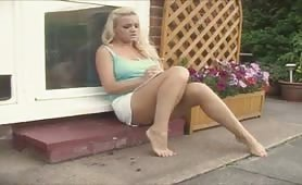 Blonde girl wetting her soft pink cotton panties outside her house after peeing desperation
