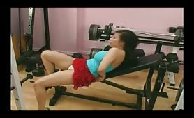 Busty Asian girl wets her white cotton panties in home gym