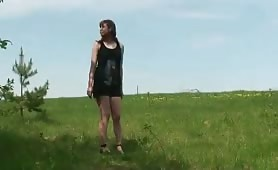 Redhair chubby teen pisses up a storm in the field