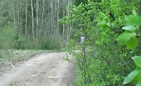 Kinky girl pisses in the middle of a forest road