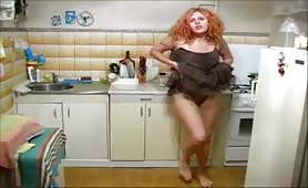 horny redhead pissing in kitchen