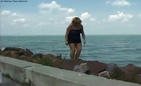 Blonde babe was walking alone the street when she felt strong temptation to piss. Look how she does it in the beach.
