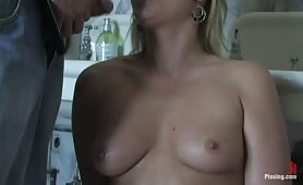 Blonde hoe gets mouth peed when rubbing pussy