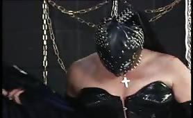 BDSM mistress gets pissed on her mask and cunt