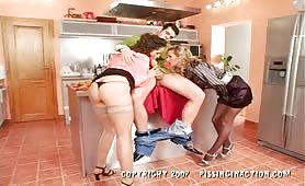 Piss soaked girls suck cock in the kitchen