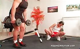 Two girls strip a guy in the gym