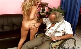 Piss lover guy in wheelchair with naked babe